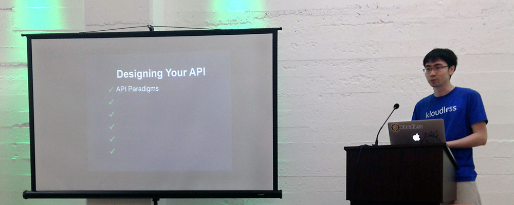 Kloudless co-founder Brian Tang speaking at AutoDevBot API Conference